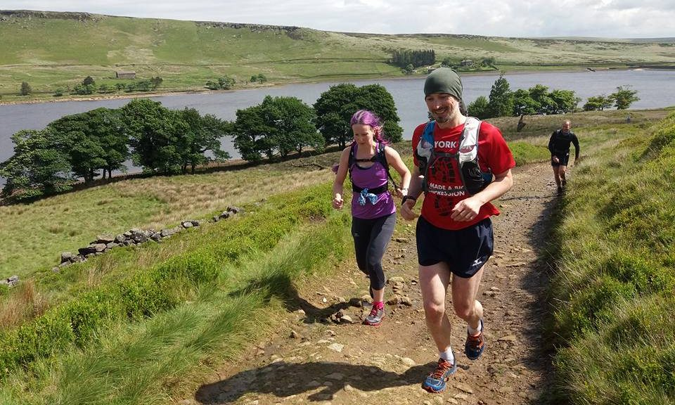 Liz and Kelly running alongside Widdop Reservoir